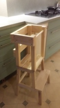 A stool with scaffolding shown next to a kitchen counter top of the same height