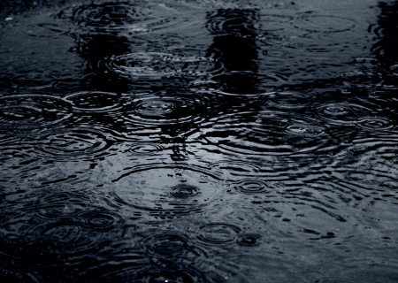 Moody_Raindrops_In_Dark_Blue_Puddle_(2387754376).jpg